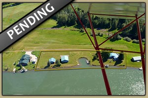 One of a kind large waterfront parcel with nice home, hanger in Clark Fork, Idaho